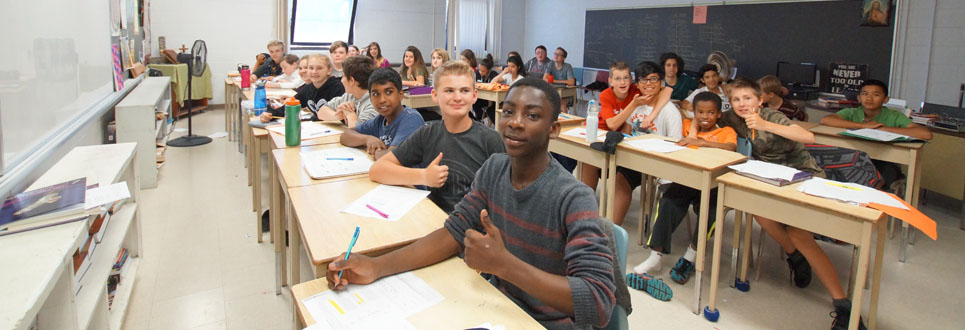 St. Theresa Catholic School Grade 8 class sitting in a classroom.
