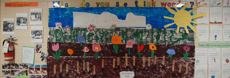 Artwork of a garden, flowers, sky and sun created by students.