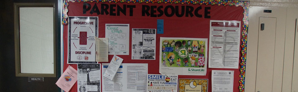 Parent resource bulletin board with various flyers.